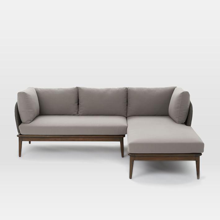 Sofa gỗ có đệm màu xám được nhiều người yêu thích sử dụng